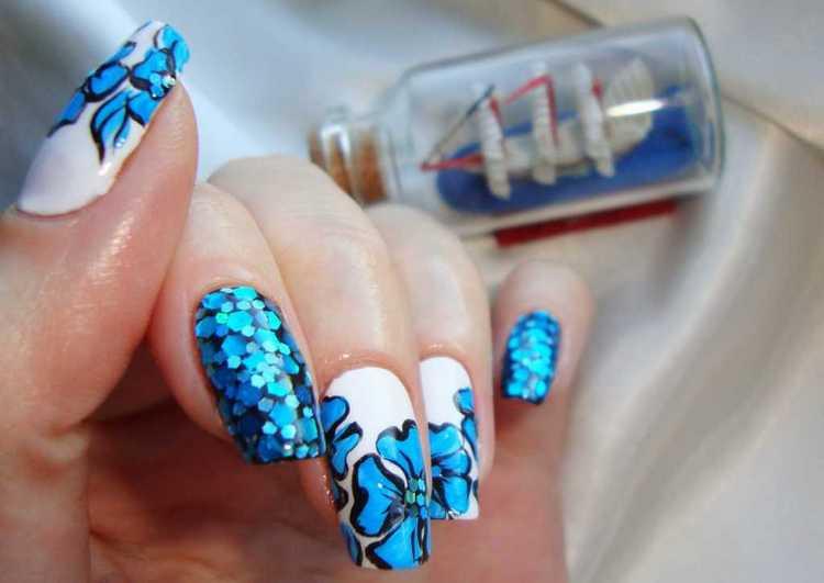 Крупные блестки помогут органично дополнить рисунок на ногтях.