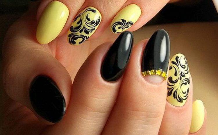 Красиво сочетается и желтый с черным в маникюре.