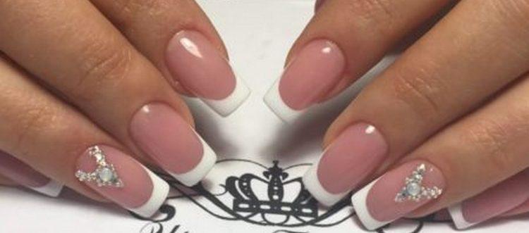 Посмотрите фото новинок дизайна ногтей со стразами.