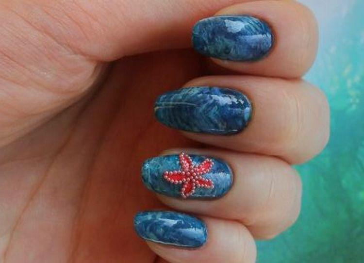В таком дизайне ногтей актуальной будет морская звезда.