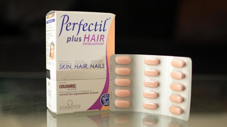 Популярные витамины для роста волос на голове это также перфектил.