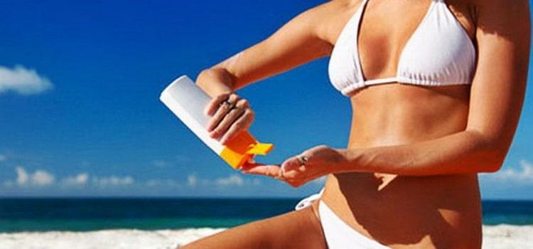 масло для загара на пляже