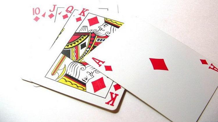 как гадать на игральных картах на любовь значение бубей